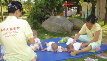 Half the Sky - Babies playing outside on ByGMR tumbling mats